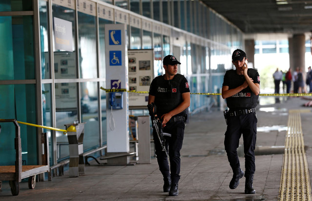 Police officers patrol at Turkey's largest airport, Istanbul Ataturk, following yesterday's blast June 29, 2016. (Photo by Osman Orsal/Reuters)