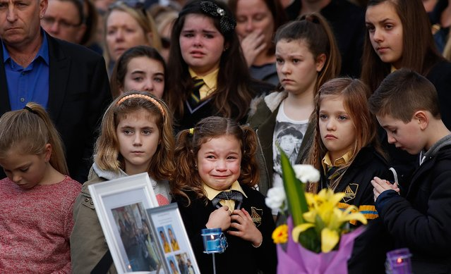 Mourners attend a memorial service held for a family of five killed in the flight MH17 disaster, in the suburb of Eynesbury in Melbourne, Australia, on Jule 20, 2014. Shaliza Zain Dewa, husband Johannes van den Hende and their children Piers, Marnix and Margaux, aged 15, 12 and 8 were among the 28 Australians on board the Malaysia Airlines flight that crashed killing all 298 on board. (Photo by Paul Jeffers/Getty Images)