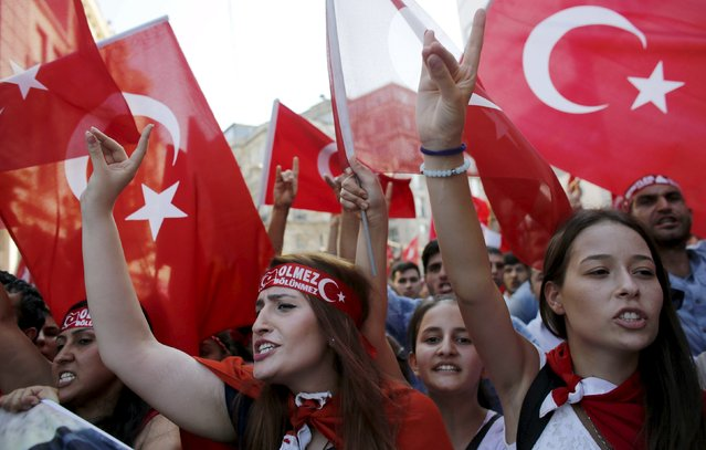 Demonstrators wave Turkish flags as they shout nationalist slogans during a protest against Kurdistan Workers' Party (PKK) in central Istanbul, Turkey, August 16, 2015. (Photo by Murad Sezer/Reuters)