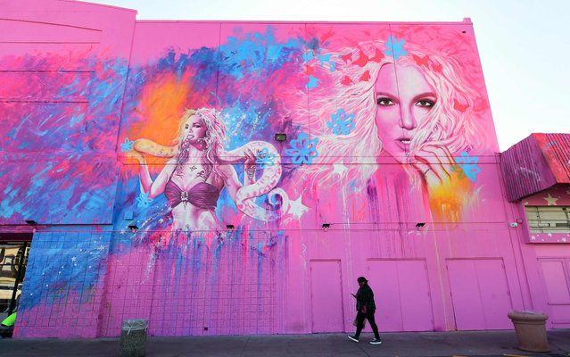 """A pedestrian walks past """"The Zone"""", a pop-up experience and retail store celebrating the career of US singer-songwriter Britney Spears, on January 29, 2020 in Los Angeles. The exhibit which opens from January 31 to April 26, 2020, promises to immerse fans in the life and legacy of the pop star, offering shareable moments in 10 different rooms based on Britney Spears' most memorable music videos. (Photo by Frederic J. Brown/AFP Photo)"""