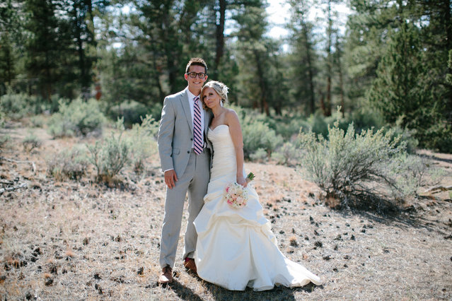 Wedding photographer, Josh Newton, has managed to turn a natural disaster into an amazing photo shoot opportunity. On June 7, 2014 Michael Wolber and April Hartley were getting ready to walk down the aisle in Rock Springs Ranch, Bend, Oregon, USA when firefighters alerted them to nearby wildfires gaining momentum and instructed them to flee to a safer location. Instead of leaving immediately, the wedding coordinator talked the firemen into letting the couple get married if they shortened the ceremony. (Photo by Josh Newton/IMP)