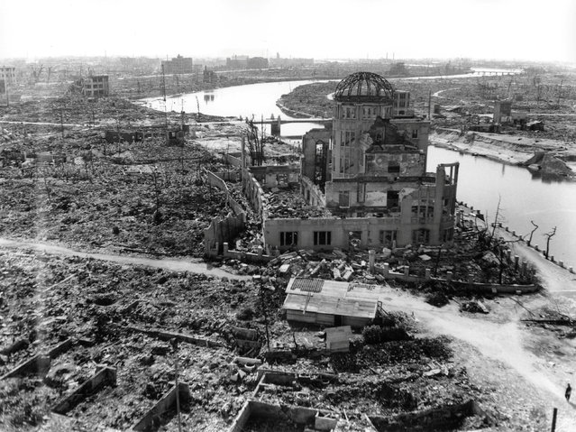 The gutted Hiroshima Prefectural Industrial Promotion Hall, currently known as Atomic Bomb Dome or A-Bomb Dome, is seen after the atomic bombing of Hiroshima, Japan, on August 6, 1945, in this handout photo taken by U.S. Army in November, 1945, and distributed by the Hiroshima Peace Memorial Museum. (Photo by Reuters/U.S. Army/Hiroshima Peace Memorial Museum)