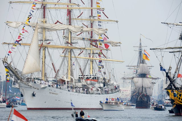 Poland's Tall ship Dar Mlodziezy is seen during the Sail-In Parade marking the beginning of the Sail Amsterdam 2015 nautical festival, held every five years, in Amsterdam, Netherlands, August 19, 2015. (Photo by Toussaint Kluiters/Reuters/United Photos)