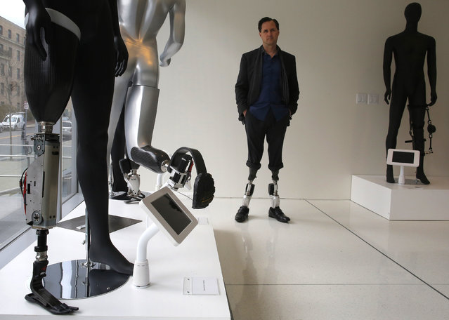 Professor Hugh Herr, who heads the Biomechatronics research group at the MIT Media Lab, stands amid mannequins displaying various bionic limbs his lab has developed at the Massachusetts Institute of Technology in Cambridge, Massachusetts April 4, 2014. (Photo by Brian Snyder/Reuters)