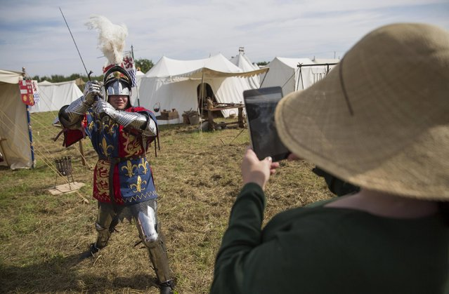 A historical re-enactor poses for a photograph in a living history camp  as he prepares to take part in an anniversary event for the Battle of Bosworth near Market Bosworth in central Britain August 22, 2015. (Photo by Neil Hall/Reuters)