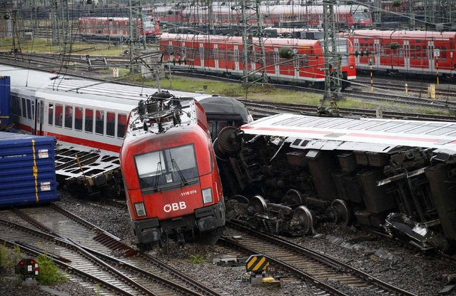 A damaged locomotive is pictured at the scene of a train crash in Mannheim August 2, 2014. A German passenger train collided with a freight train late on Friday, injuring 42 people, 4 of them seriously, police said. (Photo by Ralph Orlowski/Reuters)