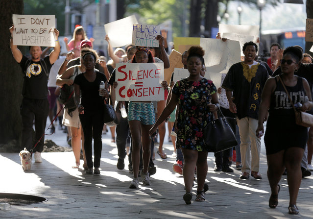 Demonstrators with Black Lives Matter march during a protest at the Department of Justice in Washington, U.S., July 8, 2016. (Photo by Joshua Roberts/Reuters)