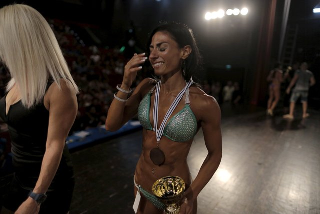 Palestinian Anoush Belian cries as she leaves the stage after winning a bodybuilding competition in Tel Aviv, Israel August 22, 2015. (Photo by Ammar Awad/Reuters)