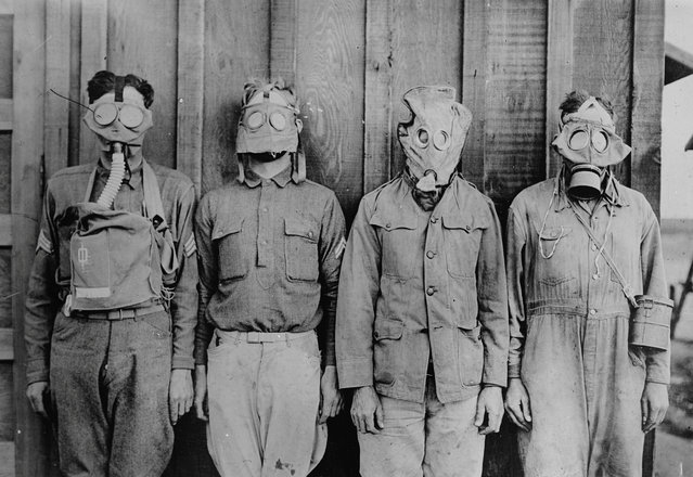 American, British, French, and German gas masks are seen in an undated photo taken during the First World War. (Photo by Library of Congress via Reuters)
