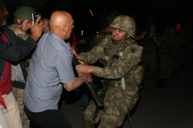 A group of soldiers, attended Parallel State/Gulenist Terrorist Organization's coup attempt, are being neutralized after they tried to storm into state run Turkish Radio and Television Corporation (TRT) in Ankara, Turkey on July 16, 2016 while people are reacting against military coup attempt. Parallel state is an illegal organization backed by U.S.-based preacher Fethullah Gulen. (Photo by Cem Ozdel/Anadolu Agency/Getty Images)