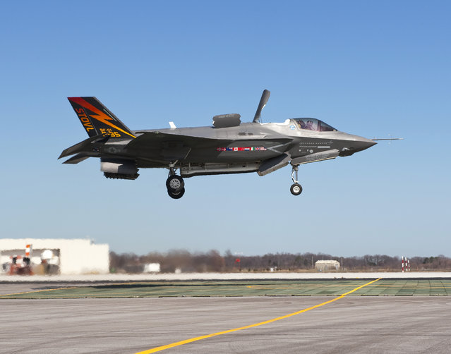 The supersonic Lockheed Martin F-35B Lightning II stealth fighter, piloted by Graham Tomlinson, lands vertically for the first time at Naval Air Station Patuxent River, Maryland on March 18, 2010. (Photo by Andy Wolfe/Reuters/Lockheed Martin)