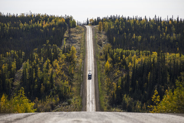 A truck rumbles down 'the roller coaster', a series of steep hills along the Dalton Highway near Yukon River Camp, Alaska, USA, 03 September 2017. (Photo by Jim Lo Scalzo/EPA)