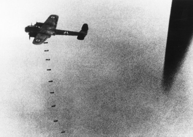 Bomb drop over England – an enemy plane drops a first series of bombs over England during an attack on September 9, 1940. (Photo by AP Photo)