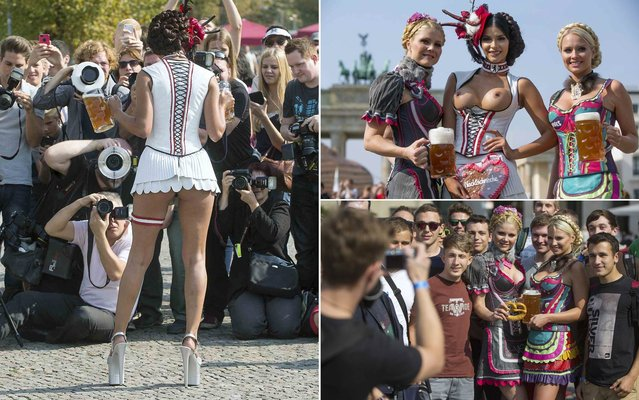 German presenter, model, DJ and singer Micaela Schaefer bared her beasts on September 16, 2014 at Brandenburg Gate in Berlin, dressed in a Dirndl, typical Bavarian dress traditionally used to celebrate Oktoberfest. Schaefer was joined by two other models promoting the dresses designed by designer Rodan, who have specifically provided Schaefer with the dress to celebrate the iconic German festival. (Photo by Hannibal/Reuters)