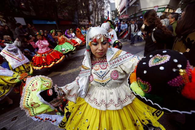 "Members of a dance troupe perform during a parade of the Bolivian community living in Chile, in Santiago, Chile, 06 August 2016. Dozens of Bolivians participated in the parade with religious dances to pay tribute to the ""Virgen Morena de Copacabana"", the patron saint of Bolivia. (Photo by Esteban Garay/EPA)"