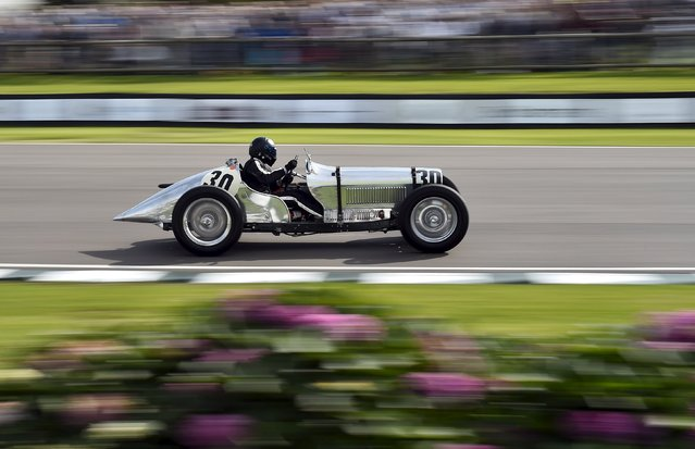 A car enthusiast races at the Goodwood Revival historic motor racing festival in Goodwood, near Chichester in south England, Britain, September 11, 2015. (Photo by Toby Melville/Reuters)