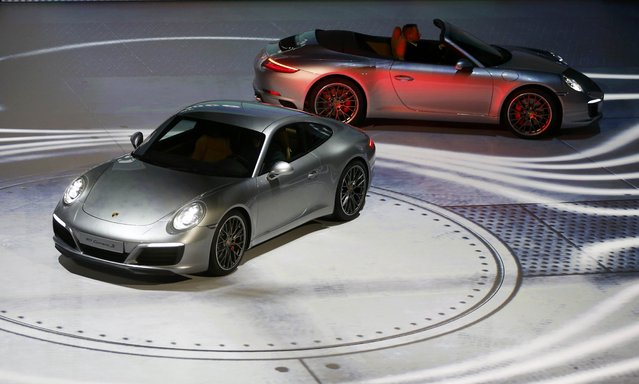 New Porsche 911 Carrera S cars are presented during the Volkswagen group night ahead of the Frankfurt Motor Show (IAA) in Frankfurt, Germany, September 14, 2015. (Photo by Kai Pfaffenbach/Reuters)
