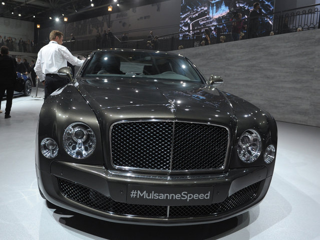 A Bentley MulsanneSpeed is presented at the Volkswagen Group Night show on October 1, 2014 in Paris  prior to the opening on October 2nd of the Paris Auto show 2014 Press days. (Photo by Eric Piermont/AFP Photo)