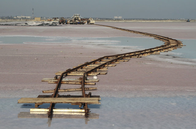 Rails lay across the bed of a drained area of a lake used for the production of salt at the Sasyk-Sivash lake near the city of Yevpatoria in Crimea, October 5, 2014. (Photo by Pavel Rebrov/Reuters)