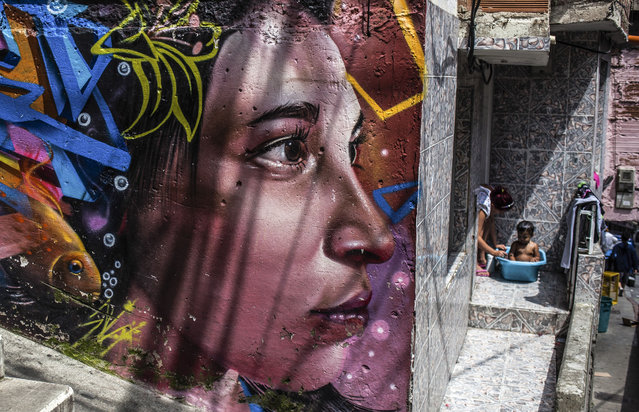 A graffiti, portraying a woman, is seen in Medellin, Colombia on November 19, 2017. (Photo by Juancho Torres/Anadolu Agency/Getty Images)