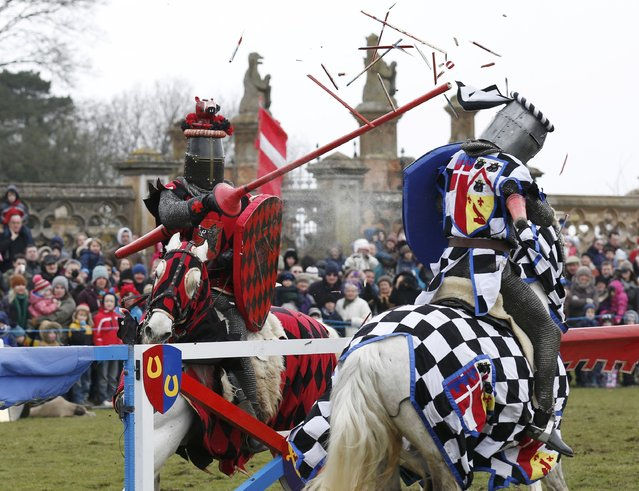 Performers dressed as medieval knights joust at Knebworth House in Hertfordshire, Britain April 1, 2013. (Photo by Olivia Harris/Reuters)
