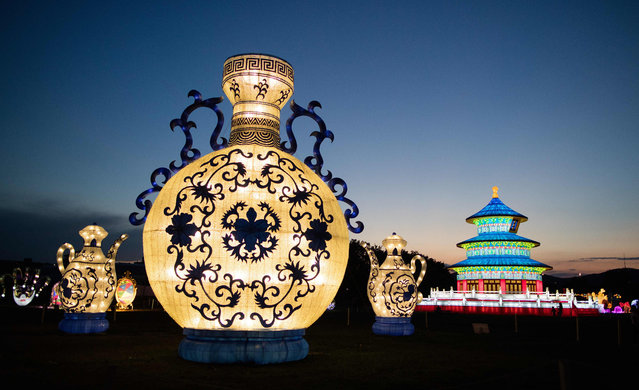 """Illuminated Chinese sculptures are seen at the China Lantern Festival """"China Magic – Festival of Light"""" in Vienna on September 1, 2016. The show is taking place from September 1 to 9, 2016 in Vienna. (Photo by Georg Hochmut/AFP Photo)"""
