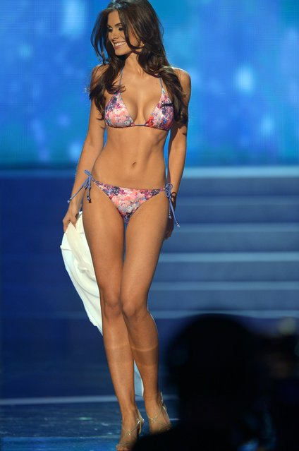 Miss Brazil, Gabriela Markus, walks on stage during the Miss Universe Pageant at Planet Hollywood in Las Vegas, Nevada on December 19, 2012.  Miss USA, Olivia Culpo was crowned Miss Universe 2012,  beating out beauties from around the world to claim the coveted title.  The title of first runner-up title went to the contestant from the Philippines, Janine Tugonon. (Photo by Joe Klamar/AFP Photo)