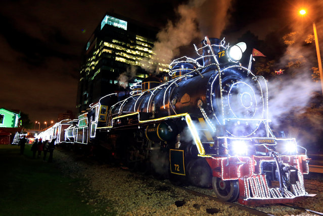 A tourist train is decorated with Christmas lights in Bogotá, Colombia on December 10, 2017. (Photo by Jaime Saldarriaga/Reuters)
