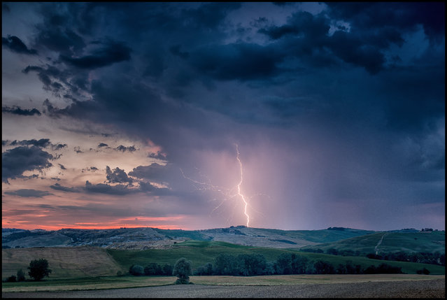 """Tuscan Lightning"". I captured this lightning near Pienza in Tuscany. Photo location: Italy. (Photo and caption by Oliver Hartmann/National Geographic Photo Contest)"