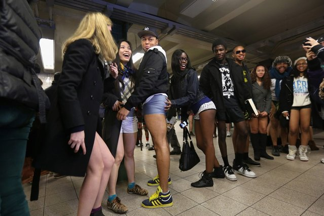 "NEW YORK, NY - JANUARY 13:  Pantless people pose for photos at the Union Square subway station on January 13, 2013 in New York City. Thousands of people participated in the 12th annual No Pants Subway Ride, organized by New York City prank collective Improv Everywhere. During the afternoon winter event, participants boarded separate subway stops and removed their pants, pretending that they did not know each other. The event, refered to as a ""celebration of silliness"" is designed to make fellow subway riders laugh and smile.  (Photo by John Moore/Getty Images)"