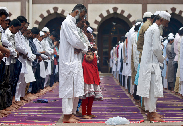 A young Muslim girl reacts as she attends the third Friday prayers of the fasting month of Ramadan inside a mosque in Bengaluru, India, June 16, 2017. (Photo by Abhishek N. Chinnappa/Reuters)