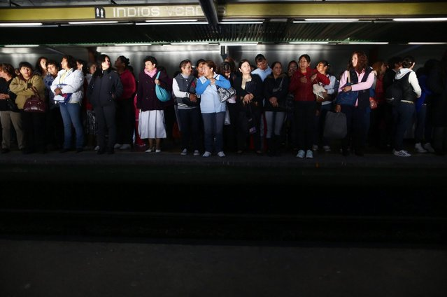 The early morning sun shines on women while they wait to board the Women-Only passenger car at a subway station in Mexico City October 24, 2014. (Photo by Edgard Garrido/Reuters)