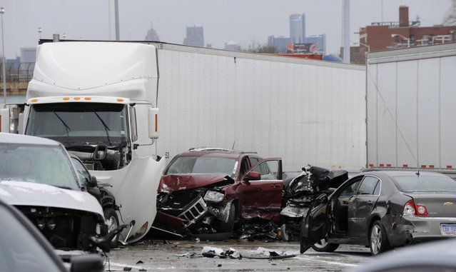 A section of multi-vehicle accident on Interstate 75 is shown in Detroit, Thursday, January 31, 2013. Snow squalls and slippery roads led to a series of accidents that left at least three people dead and 20 injured on a mile-long stretch of southbound I-75. More than two dozen vehicles, including tractor-trailers, were involved in the pileups. (Photo by David Coates/The Detroit News/AP Photo)