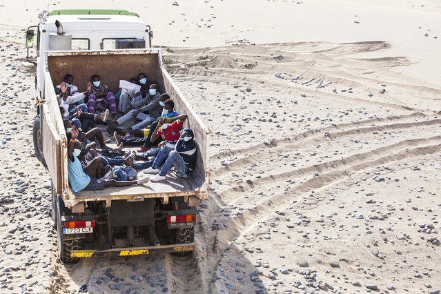 Would-be immigrants sit inside a truck at Maspalomas beach on Gran Canaria in Spain's Canary Islands. (Photo by Borja Suarez/Reuters)