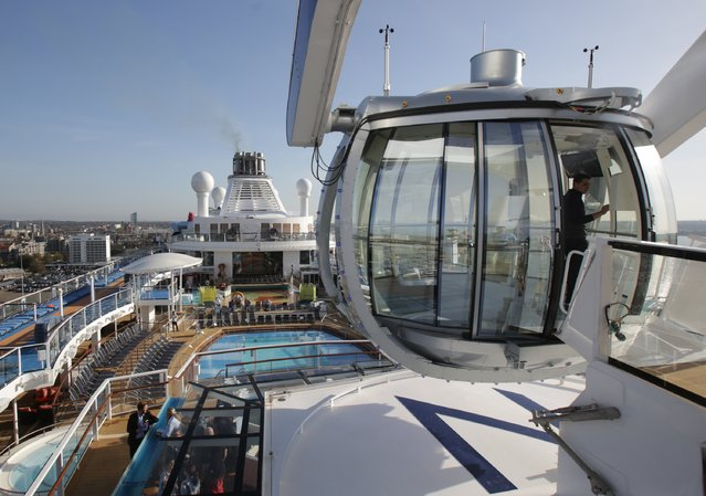 People enter the North Star observation capsule onboard the cruise ship Quantum of the Seas which is currently docked at Southampton on October 31, 2014 in Southampton, England. (Photo by Matt Cardy/Getty Images)
