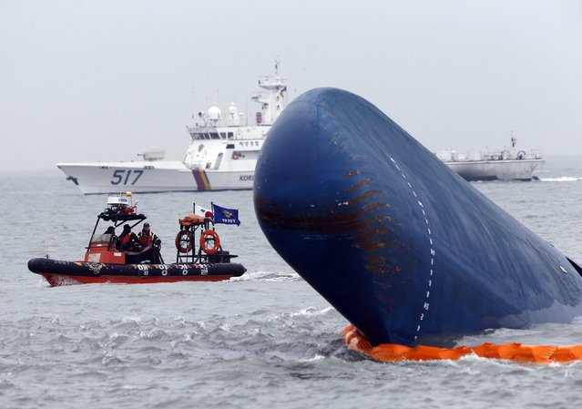 """Rescue boats sail around the South Korean passenger ship """"Sewol"""" which sank, during their rescue operation in the sea off Jindo, in this April 17, 2014 file photograph. A South Korean court on November 11, 2014 found the captain of the ferry that capsized in April killing more than 300 passengers guilty of negligence and sentenced him to 36 years in jail, but acquitted him of the homicide charge for which prosecutors had sought the death penalty. (Photo by Kim Kyung-Hoon/Reuters)"""