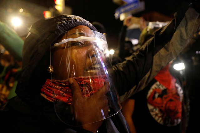 A demonstrator with a face shield takes part in a protest over the death of a Black man, Daniel Prude, after police put a spit hood over his head during an arrest on March 23, in Rochester, New York, U.S. on September 5, 2020. (Photo by Brendan McDermid/Reuters)