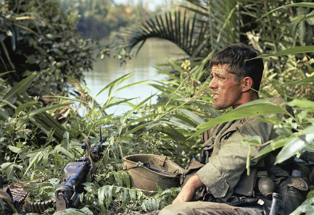 Photo shows Close Up of Rick Holmes of C company, 2nd battalion, 503rd infantry, 173 rd airborne brigade, sitting down on January 3, 1966 in Vietnam. (Photo by AP Photo)