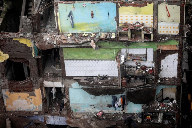Exposed walls, with household items still intact, are seen in what were rooms of a three-storey residential building after a portion of it collapsed in Bhiwandi on the outskirts of Mumbai, India, September 21, 2020. (Photo by Francis Mascarenhas/Reuters)