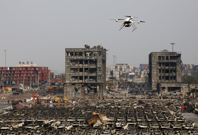 A drone operated by paramilitary police flies over the site the explosions at Binhai new district in Tianjin, China, August 17, 2015. (Photo by Kim Kyung-Hoon/Reuters)