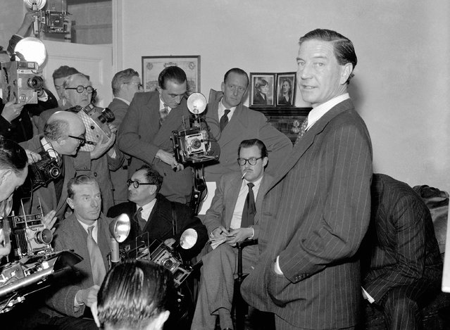"""In this file photo dated November 8, 1955, former British diplomat who was at that time accused of spying for Russia, during a press conference at his parents' home in London on Nov. 8, 1955.  In a 1981 film posted online Monday April 4, 2016, by the BBC, notorious British spy Kim Philby is shown in newly uncovered footage addressing East German spies, """"comrades"""", about his life as a double agent secretly helping the Soviet Union, in what is the closest thing to a full confession yet to surface. Philby died in 1988 in his adopted Soviet homeland. (Photo by AP Photo)"""