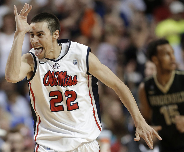 Mississippi guard Marshall Henderson (22) gestures after he made a 3-point shot against Vanderbilt during the second half of an NCAA college basketball game in the semifinals of the Southeastern Conference tournament, Saturday, March 16, 2013, in Nashville, Tenn. (Photo by John Bazemore/AP Photo)