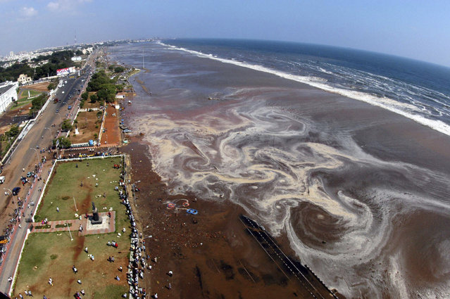 The aerial view of Marina beach after a tsunami triggered by an earthquake in the Indian Ocean hit the area in the southern Indian city of Madras in this December 26, 2004 file photo. (Photo by Reuters/Babu)