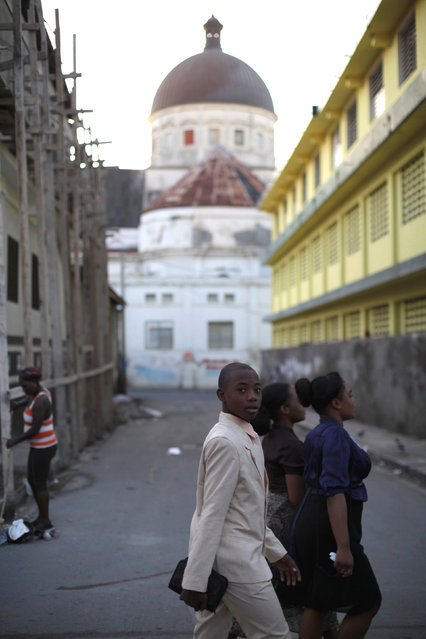 People walk near the Notre Dame cathedral in Cap Haitien, Haiti, September 18, 2016. (Photo by Andres Martinez Casares/Reuters)