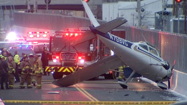 This photo provided by NBC Connecticut News shows the single engine plane that landed on a bus-only roadway in West Hartford, Conn., Saturday, November 29, 2014. Danny Hall, a 48-year-old roofing company owner from Torrington, walked away from the crash landing with only soreness in his back. In 2008, he landed his plane in a river after the engine failed. (Photo by Gregg Monte/AP Photo/NBC Connecticut News)