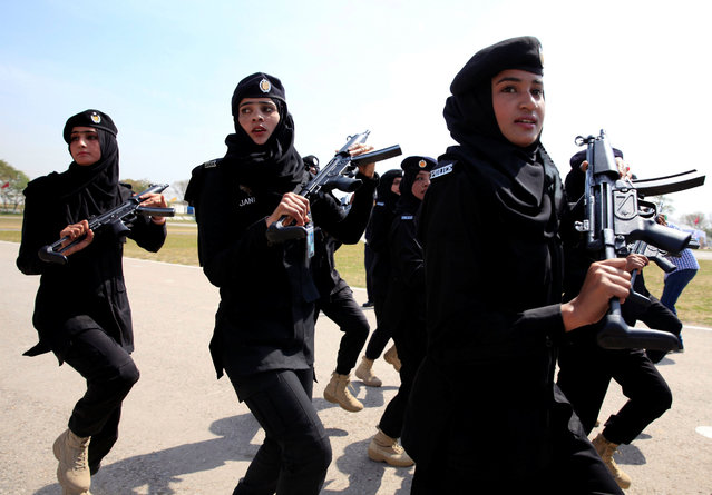 Female members of police commando march during a ceremony on International Women's Day, at the police headquarters in Islamabad, Pakistan March 8, 2018. (Photo by Faisal Mahmood/Reuters)