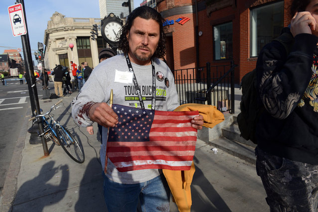 Carlos Arredondo, who was at the finish line of the 117th Boston Marathon when two explosives detonated, leaves the scene on April 15, 2013 in Boston, Massachusetts. (Photo by Darren McCollester)