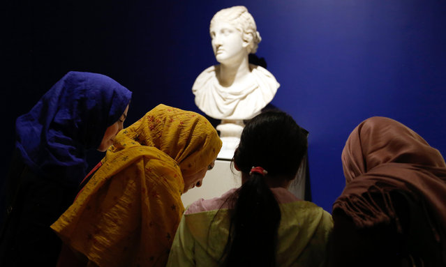 "Iranians visit the exhibition ""The Louvre in Tehran"" at the National Museum in central Tehran, Iran, 23 March 2018. A collection of 50 artworks from the various departments of the Louvre Museum in Paris, France is on show at the National Museum of Iran, the first major exhibition by the Western museum in Tehran. (Photo by Abedin Taherkenareh/EPA/EFE)"