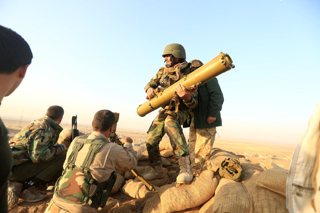 Peshmerga forces prepare their anti-tank guided missiles in front of Islamic state militants' positions  at the town of Naweran near Mosul, Iraq October 20, 2016. (Photo by Zohra Bensemra/Reuters)