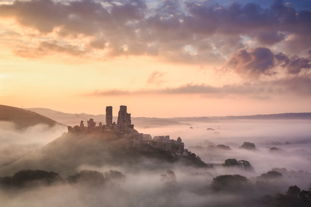 Corfe Castle, Dorset, UK, 2016. Corfe Castle, in the Purbeck Hills between Swanage and Wareham, is one of the most romantic ruins in the UK and autumn sees this area at its best. Morning mists are common and walks in the hills provide the perfect vantage points to look down on the castle and across the heathland to Poole harbour. (Photo by Mark Bauer)